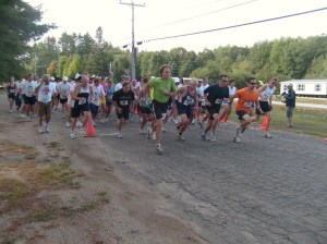 Tom (green jersey) running the race
